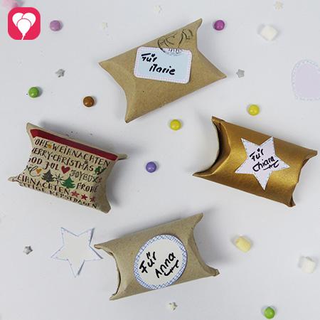 Upcycling Geschenkverpackungen aus Klopapierrollen und Stickern zum Ausdrucken