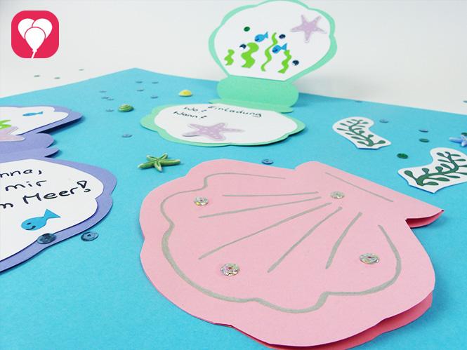 DIY Muschel Einladung basteln in verschiedenen Farben