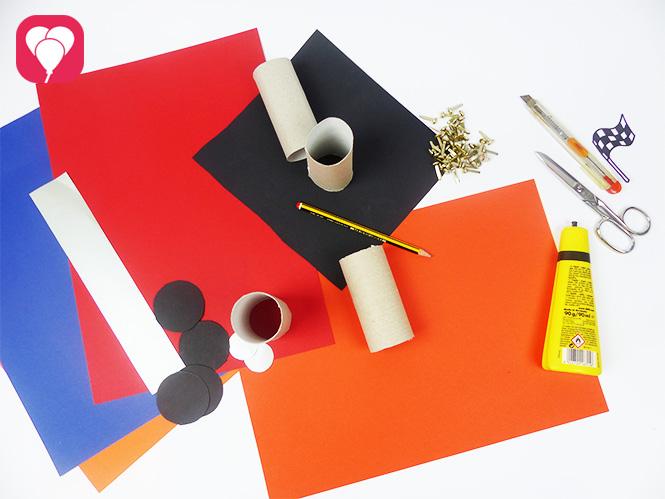 DIY Rennauto basteln - Material - Klopapierrollen Tonpapier Kleber Schere Musterklammern Stifte