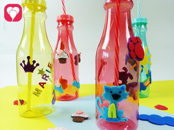 Bunte Trinkflaschen mit Stickern dekorieren