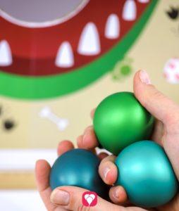 Dino Wurfspiel - Wurfbälle richten