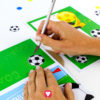 Soccer Goal Wall Invitation - cut out soccer balls with cutter knife